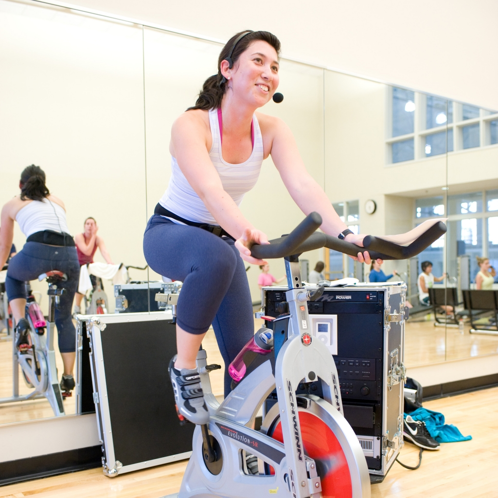 Spinning instructor leading class