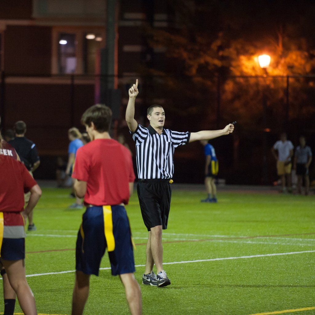 intramural official reffing a flag football game
