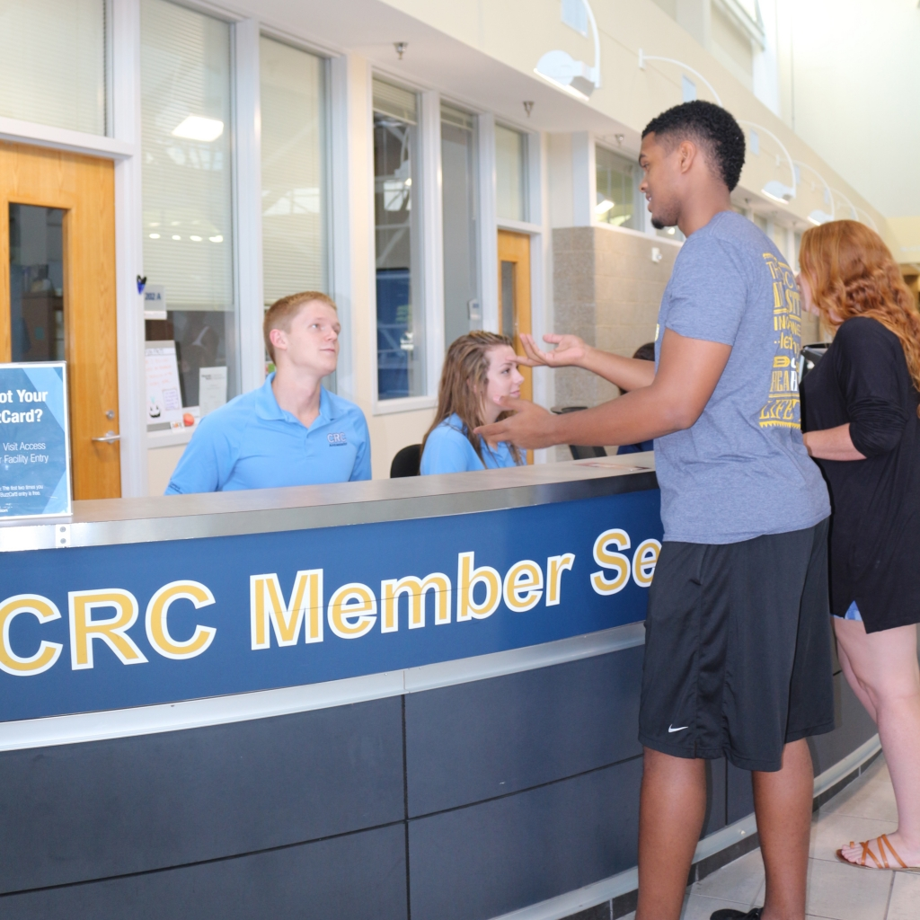 Students assisting members at front desk