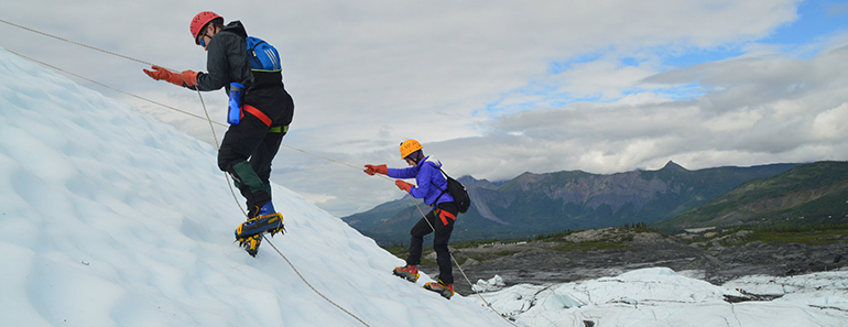 2 students repelling on a glacier